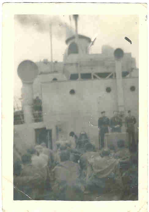 photograph of Sunday service at sea in 1944 or 1945 on the Mulholland